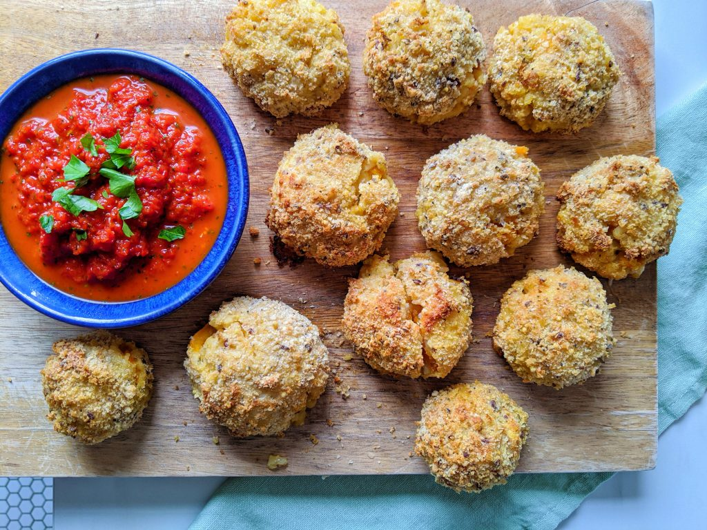 baked arancini with red pepper dip